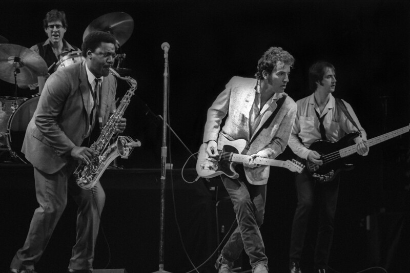 OAKLAND, CA-OCTOBER 27: Bruce Springsteen performs at the Oakland Coliseum Arena on October 27, 1980. (L-R): Max Weinberg, Clarence Clemons, Bruce Springsteen, Garry Tallent)  (Photo by Clayton Call/Redferns)