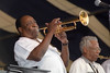 NEW ORLEANS, LA-APRIL 25: Dave Bartholomew performs with Fats Domino at the New Orleans Jazz & Heritage Festival on April 25, 1999. (L-R): Dave Bartholomew, Herb Hardesty  (Photo by Clayton Call/Redferns)