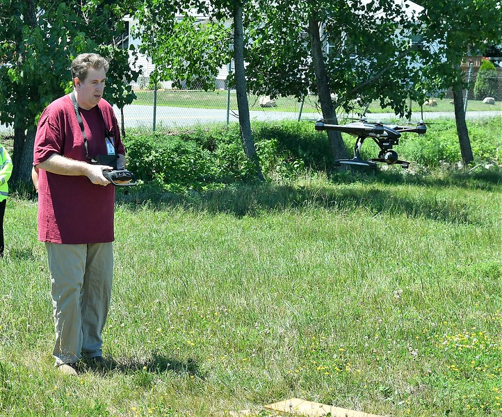 Bob Gutermuth lands drone during the search for lost lambs.<br /> Sentinel & Enterpise / Jim Fay