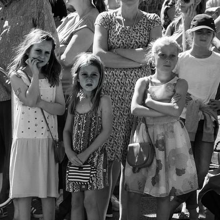 Grils watch Aldeburgh carnival.
