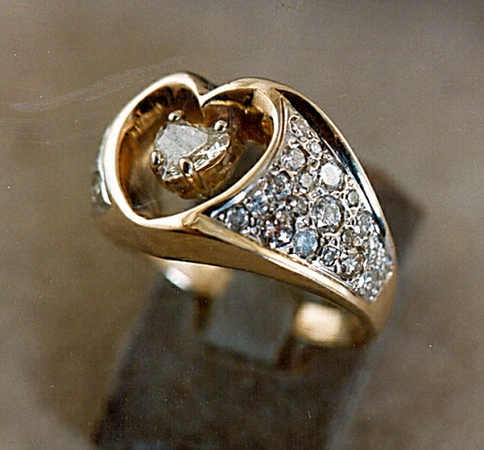 """Two families contributed old gold and gems to create this """"Heart within a Heart"""" ring as a wedding ring."""