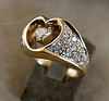 "Two families contributed old gold and gems to create this ""Heart within a Heart"" ring as a wedding ring."