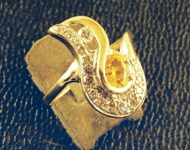 """Bead and Bright cut with Diamonds and a Citrine stone.  This ring was designed to """"fit"""" the stone which the customer loved."""