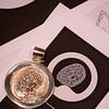 Finished fingerprint pendant with original camera ready artwork one.