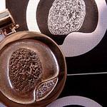 Finished fingerprint pendant with original camera ready artwork too.