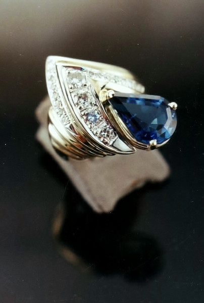 A London Blue Topaz and diamonds set into a ring that was made using the Lost Wax Casting method and gold the client already owned.
