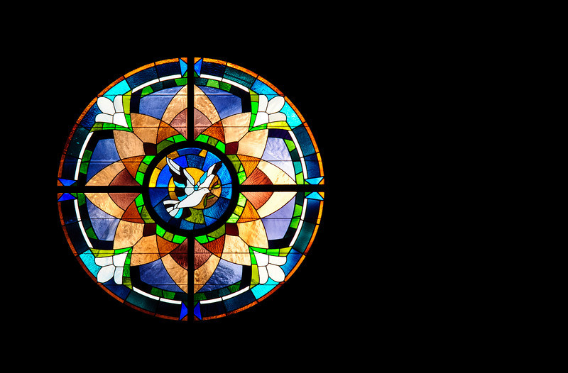 Peace, dove, stained glass <p></p> This photograph was taken inside Prince of Peace Catholic Church in Hoover, AL. The sunlight was strong through the glass and made for a challenging exposure.