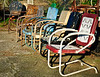 "have a seat, relax, watch the world go by <p></p> This photograph was made in front of ""On A Shoestring"" in Bluff Park, AL.  When I saw the chairs, I wondered what stories, what they had seen over the years."