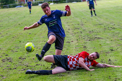 Lostocks Danny Martin is tackled by a Winnington Avenue player in a 2020/21 pre season friendly