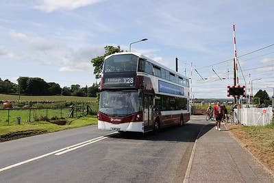 587 crosses the railway at Kirknewton 24 June 2020