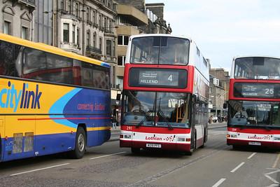 291 squeezes between two broken down buses on Princes Street