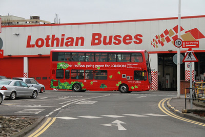 HV3 poses under the Lothian Buses sign