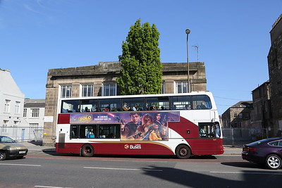 814 with the double advert.  Shame about the tree sticking out of the roof.