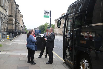 Kevin and Scott turn on the charm for their passengers before the first ever scheduled tour to Loch Lomond, the Trossachs and Doune Castle.  Monday 11th June 2018