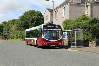 107 in Kirkliston - a cheery wave from Brian, a driver who was at First's Linlithgow depot before it closed and will know this area well.