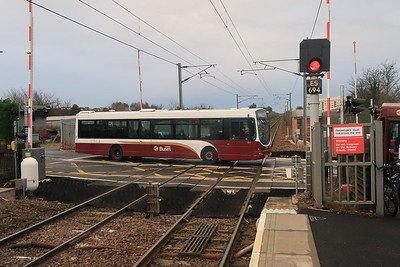 144 crosses the level crossing at Kingsknowe
