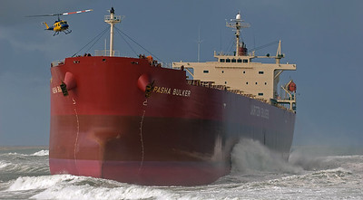 The Pasha Bulker ran aground off Nobby's Beach, Newcastle and it took a fairly serious effort to get it refloated and towed away. The Huey chopper was ferrying salvage gear on the deck at the start of the operation.