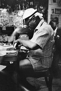 Louis Armstrong making scrapbooks