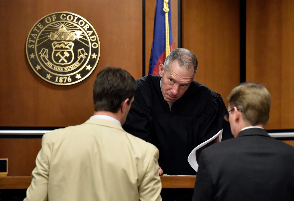 . BOULDER, CO - FEBRUARY 13, 2019:  Boulder District Judge Andrew Hartman, at center, listens to Defense Attorney Benjamin Collett, left, and Boulder County District Attorney Michael Doherty during the Louis Sebastian trial on a charge of first-degree murder in the May 2017 shooting of Christopher King, 49, at the Boulder County Justice Center on Wednesday at the Boulder County Justice Center in Boulder. For more photos of day 2 of the trial go to dailycamera.com  (Photo by Jeremy Papasso/Staff Photographer)
