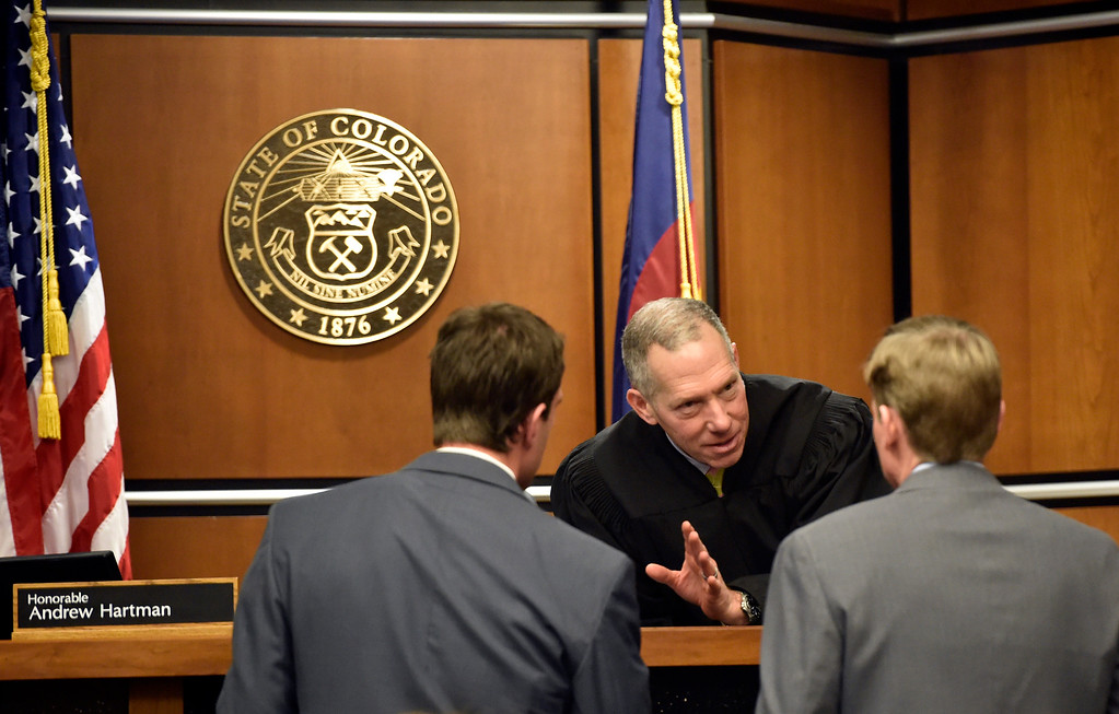 . BOULDER, CO - FEBRUARY 14, 2019:  Boulder District Judge Andrew Hartman, at center, talks with Defense Attorney Benjamin Collett, left, and Boulder County District Attorney Michael Doherty Thursday at the Boulder County Justice Center. The court conference occurred during the Louis Sebastian trial on a charge of first-degree murder in the May 2017 shooting of Christopher King.  For more photos of day 3 of the trial go to dailycamera.com (Photo by Jeremy Papasso/Staff Photographer)