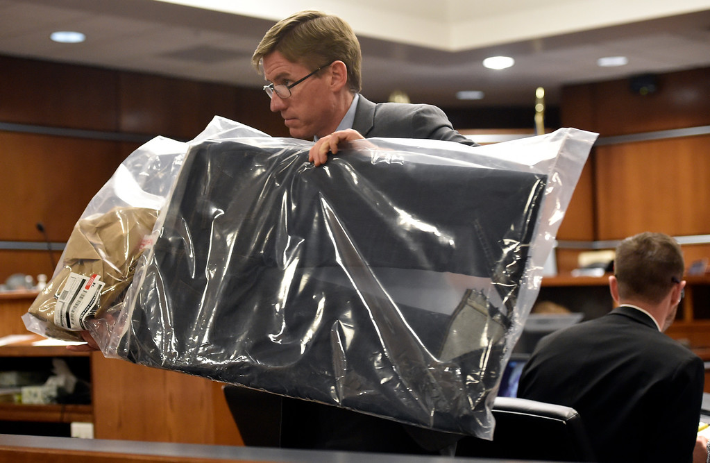 . BOULDER, CO - FEBRUARY 14, 2019:  Boulder County District Attorney Michael Doherty carries a piece of evidence to a witness Thursday, at the Boulder County Justice Center, during the Louis Sebastian trial on a charge of first-degree murder in the May 2017 shooting of Christopher King. For more photos of day 3 of the trial go to dailycamera.com (Photo by Jeremy Papasso/Staff Photographer)