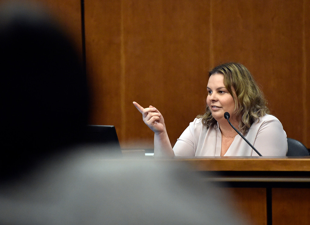 . BOULDER, CO - FEBRUARY 14, 2019:  Lorraine Horton, of Boulder, points to Louis Sebastian while testifying at his trial Thursday on a charge of first-degree murder in the May 2017 shooting of Christopher King. (Photo by Jeremy Papasso/Staff Photographer)