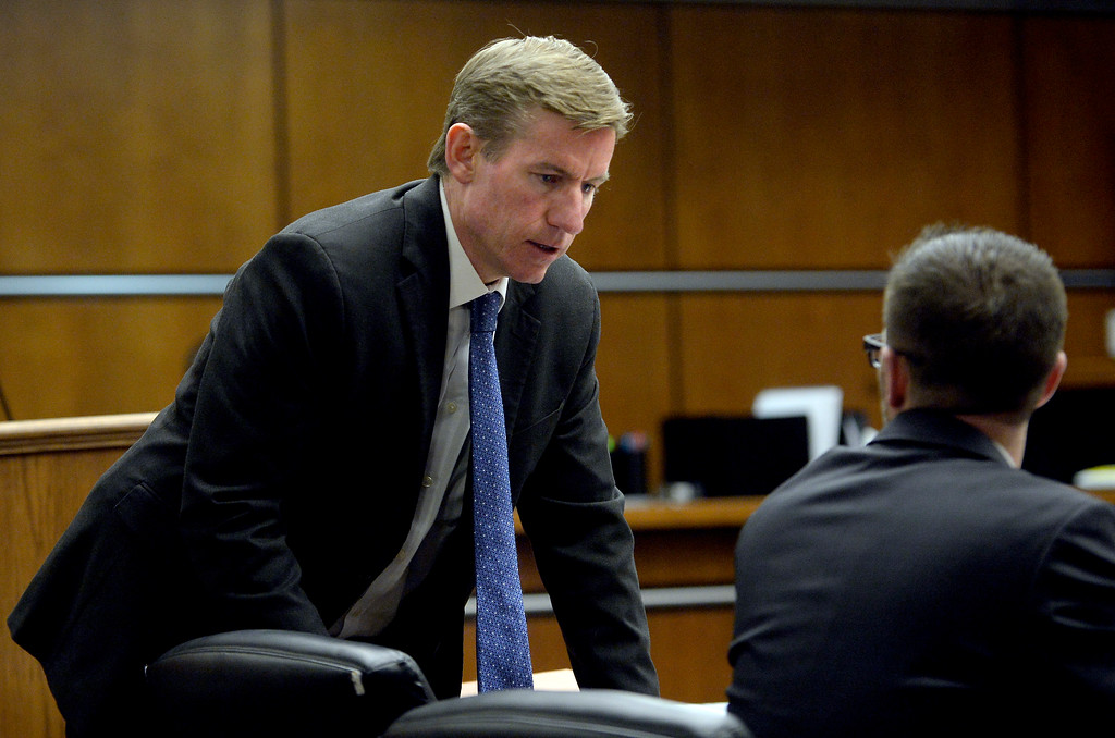 . BOULDER, CO - FEBRUARY 19:Boulder District Attorney Michael Doughty talks to Mark Grimaldi in court at the Boulder County Justice Center on Feb. 19, 2019. Testimony continued Tuesday in the murder trial of Louis Sebastian, accused of fatally shooting Christopher King at the Bramble & Hare in 2017. Sebastian is charged with first-degree murder. (Photo by Cliff Grassmick/Staff Photographer)