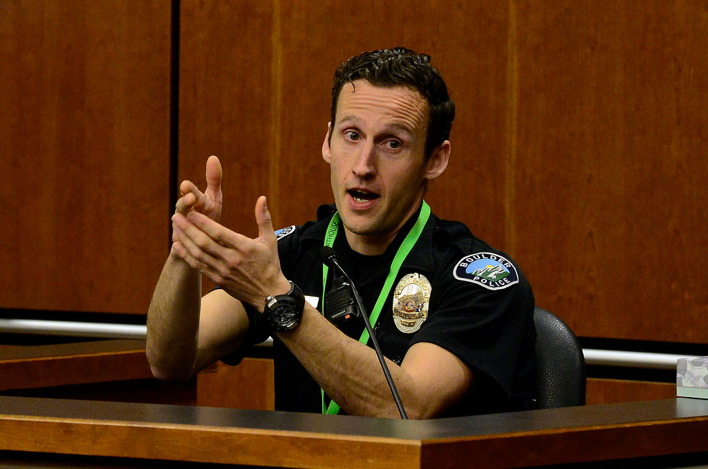 . BOULDER , CO FEBRUARY 12, 2019 Boulder Police Officer Matthew Corinth explains the different methods to hold a weapon when approaching a scene during the Louis Sebastian trial on a charge of first-degree murder in the May 2017 shooting of Christopher King, 49, on Tuesday at the Boulder County Justice Center. Corinth, who was one of the first officers on the scene did not use the high position he shows here but a safer low ready position.  For more photos go to dailycamera.com (Photo by Paul Aiken/Staff Photographer)