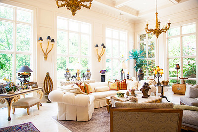 The Great Room — Surrounding the room with a gorgeous view of the garden area and wrought iron topped gazebo sitting atop four hand carved Italian Marble columns. Ruth Sandbach's design sense shines here.