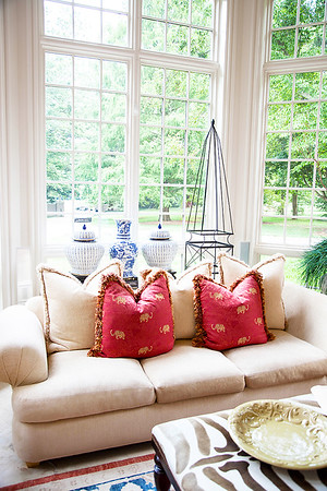 The Sunroom — Though smaller and cozy compared to many of the house's other rooms, the majestic 12' tall ceilings combined with wrap around floor to ceiling windows exhibiting the gorgeous outdoor scenery year round make it obvious as to why it's a family favorite.