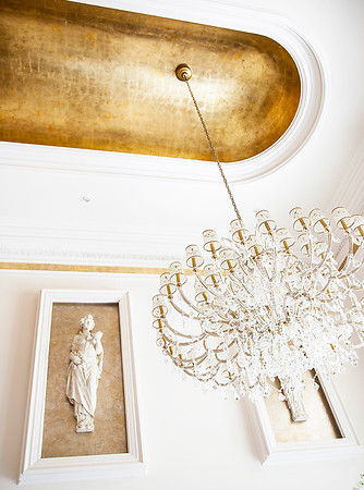 The Grand Foyer — A glance upwards, to the foyer's domed ceiling reveals a subtly elegant lightshow upon the ceiling as 5,000 hand-laid sheets of gold leafing catch the sunlight.