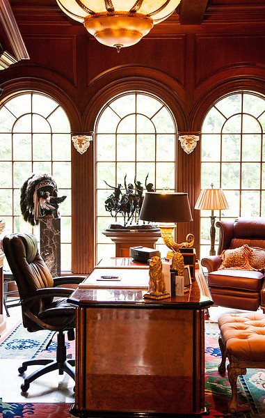 The Office/Library — From artistic details such as the two gorgeous hunt scene paintings over the fireplace, which are handpicked treasures from the couple's trip to Europe, to the authentic Indian Chief headdress statuesquely sitting atop its exhibition pedestal — there is no doubt where the man of the house goes to create fantastic new ideas.