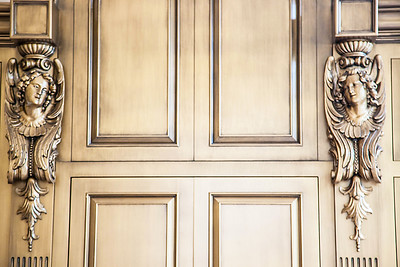 The Great Room — The master carpentry and millwork themselves are works of art, down to even the artistically stained wood and female figureheads on the custom cabinet in The Great Room.