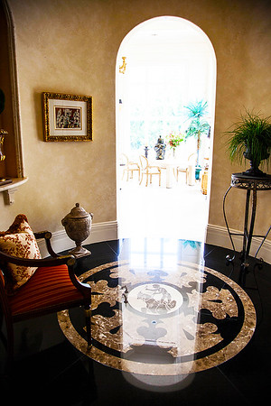 The Round Room — Upon entrance to The Kitchen you pass through the elegant round room. In each of the round rooms the magnificent floors are made of a gorgeously reflective laser cut granite.