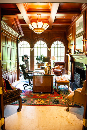 The Office/Library — Down the elegant silver leaf lined hallway leading to the Master Bedroom Suite, the 'Man of the Manor' can be found. Bill Sandbach's solid mahogany lined library is the epitome of a thinking man's sanctuary. From his collection of family treasures to his extensive collection of sculptures  by American painter, illustrator & sculptor, Frederic Remington — who specialized in depictions of the Old American West, specifically concentrating on the last quarter of the 19th century American West and images of cowboys, American Indians, and the U.S. Cavalry.