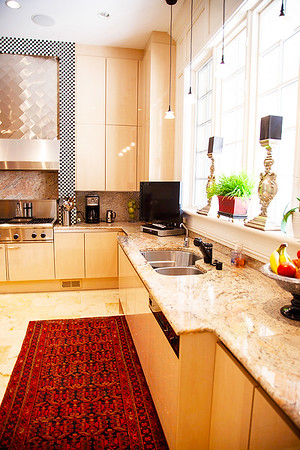 The Kitchen — The granite countertop was honed out of a mountain in Italy. The type and coloration of granite had never been seen before and was accordingly named Sandbach Granite, after the couple.