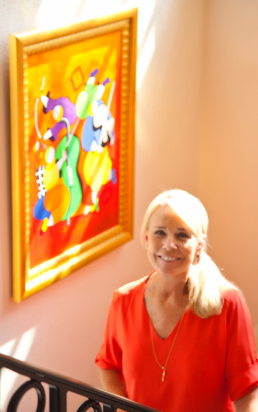 Homeowner Ruth Sandbach standing beside her exquisite artwork.