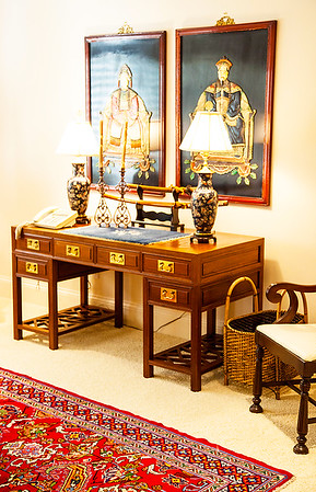 The Oriental Room — The desk is from Thailand, covered in an antique authentic opium mat. Samurai swords embellish the desk top. The two pieces of inlaid artwork hanging over the desk were purchased from Japan.