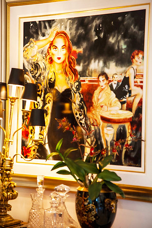 The Dining Room — Within the dining room an expressive painting of a gorgeous woman by artist, Joanna Zjawinska luxuriously overviews its guests.
