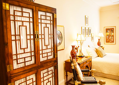 The Oriental Room — This gorgeous guest room is overflowing with exotic detail galore. A keen eye might notice the Chinese Art Prints hanging above guest bed. Many exotic details abound, artfully arranged by Ruth's amazing eye for detail.
