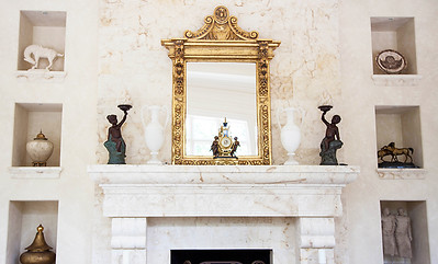 The Great Room — Ruth Sandbach's design sense shines here. She proportionately designed the largest marble fireplace to go in this room, alongside majestically tall floor to ceiling marble shelving around fireplace perfect for displaying the couple's art from their travels.