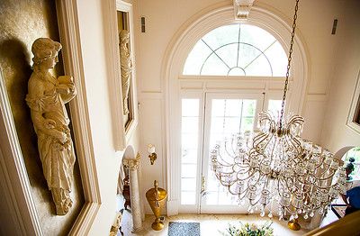 The Grand Foyer — The foyer's magnificent chandelier, that homeowner Bill & Ruth Sandbach designed, was cleverly put upon an electrical lift for ease of cleaning the crystals.