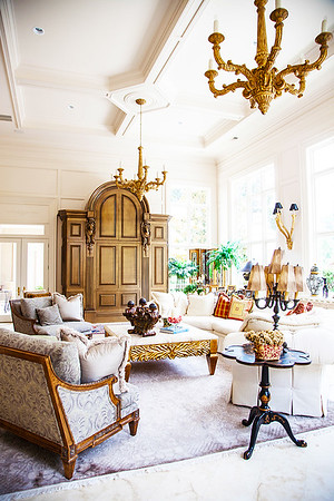 The Great Room — Majestic twin chandeliers light the expansive room.