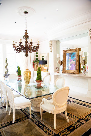 The Dining Room — Over the dining room table hangs an antique wooden candelabra from Italy, that the home's couple had updated for a modern approach whilst reminiscent of old world comfort in feeling and ambiance.