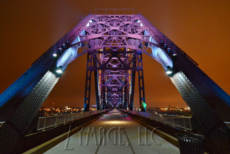 The Big Four Bridge over the Ohio River connecting Louisville, KY with Jeffersonville, IN is outfitted with colored lights. February 11, 2015. Photo by Jacob Zimmer.