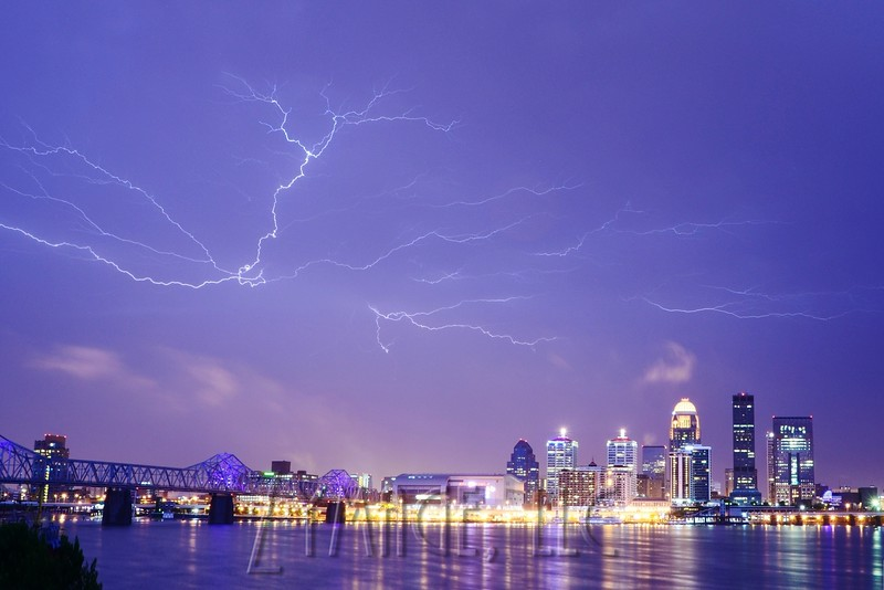 Lightning flashes across the sky over downtown Louisville. December 18, 2013.