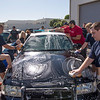 Volunteers cover every inch of a police cruiser while working to clean a fleet of the cars during a service day in Fullerton on Saturday, April 29, 2017. (Photo by Matt Masin, Orange County Register, SCNG)