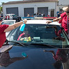Volunteers work inside and out to clean and detail a fleet of police cruisers on a service day in Fullerton on Saturday, April 29, 2017. (Photo by Matt Masin, Orange County Register, SCNG)