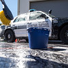 Volunteers work to clean off a fleet of police cruisers in Fullerton on Saturday, April 29, 2017. (Photo by Matt Masin, Orange County Register, SCNG)