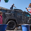 Volunteers of all ages are eager to climb onto the SWAT Bobcat vehicle while washing it for a service day along with a fleet of police cruisers in Fullerton on Saturday, April 29, 2017. (Photo by Matt Masin, Orange County Register, SCNG)